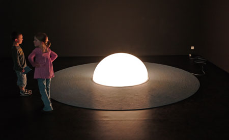 """Two children and the Christophe Berdaugeur/Marie Pejus installation """"7th Continent"""""""