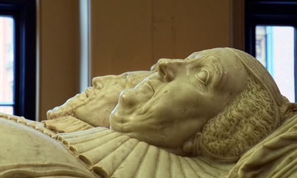 Detail of a monument to Sir Moyle Finch and his wife Elizabeth.  He died in 1614 -- she in 1634.  His eyes closed -- hers open.   (Click image to enlarge)