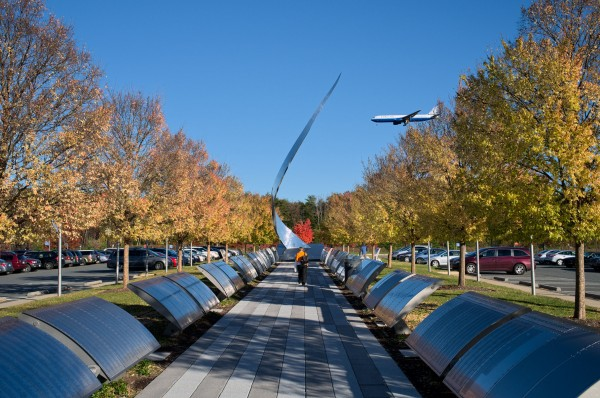 Walkway as airplanes land at Dulles.